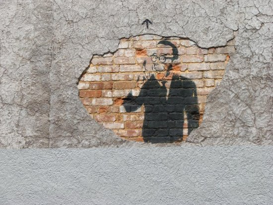 Hole in the wall graffiti. Good use of a space.