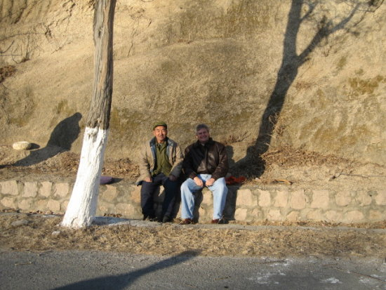 David took photos with local farmers while on our way to the Great Wall in beijing
