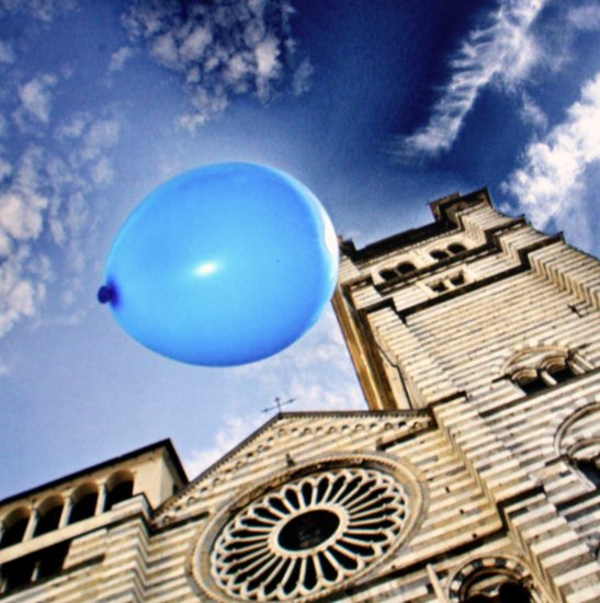 ballon blue sky blue clouds building
