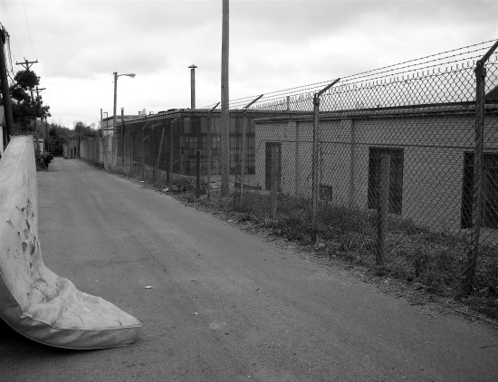 alley chainlink fence blackwhite bw mattress abandoned
