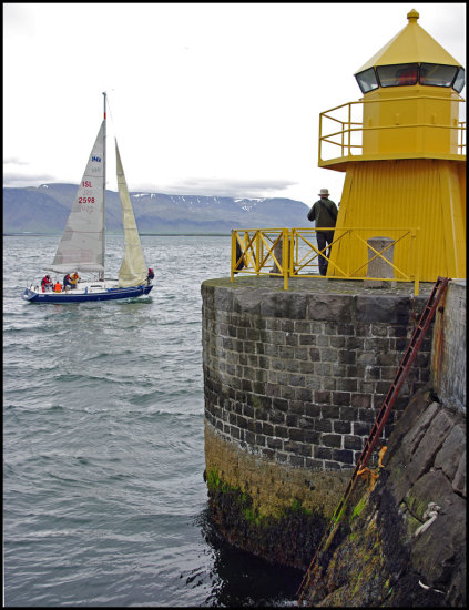 Reykjavik harbour ander sea lighthouse yellow wind ocean iceland