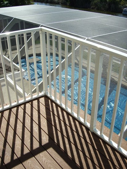 BALCONY OFF MASTER LOOKING DOWN AT POOL FLORIDA RENTAL