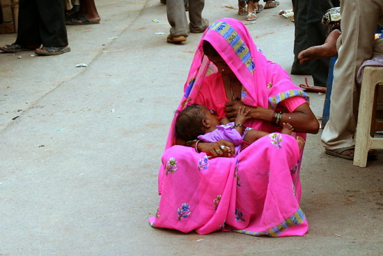 Mothers Milk Is Best A Village Woman Sat Down To Feed Her Child In
