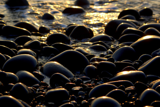 sun pebbles gold sea