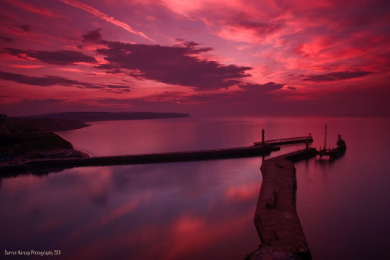 SUNSET OVER LOOKING WHITBY HARBOUR