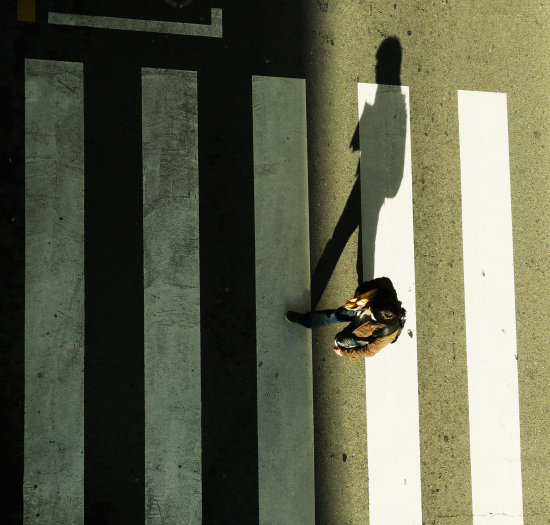 zebra crossing shadow schoolboy