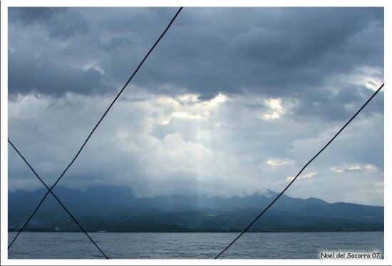A Ray of sunlight peeking through the clouds.