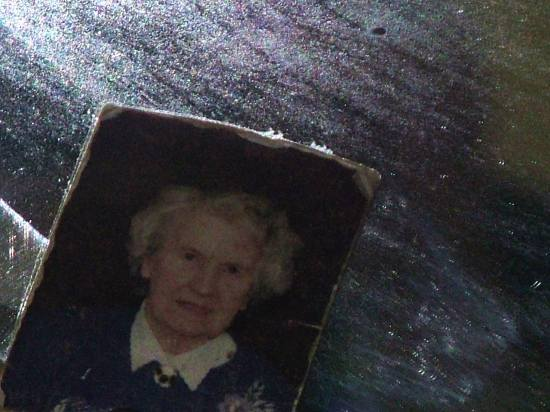 Remembering the dead. This is a shot of my nanna thats hanging on a mirror in my granddads livin...