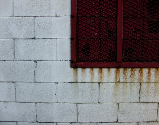 red rust window white wall