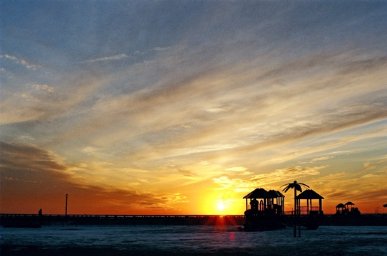 ConeyIsland white water yellow orange clouds sky winter sunset NewYork