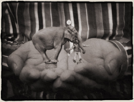 hands giant small miniature elephant BW vintage sepia