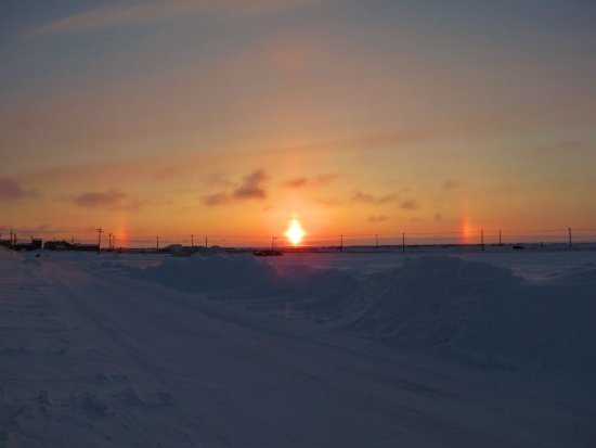 icebow over Barrow, Alaska...a condition caused by sun reflecting off ice crystals, related to su...