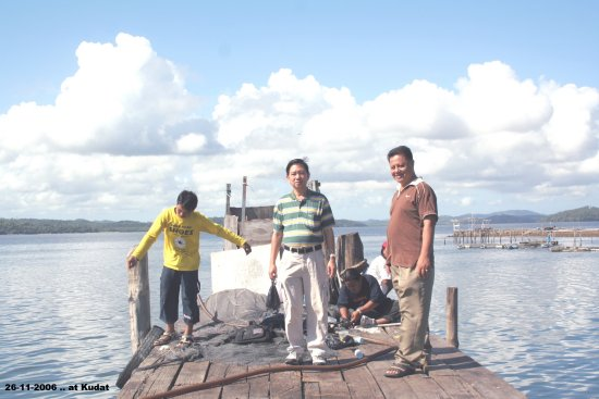 Thien with Kadir .. at the fish jetty in Kudat.