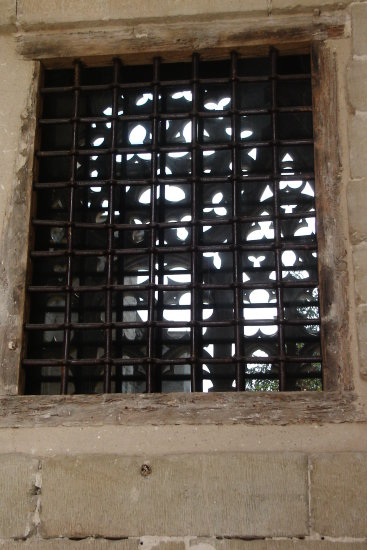 seu vella lleida old cathedral cloister detail window bars reflected