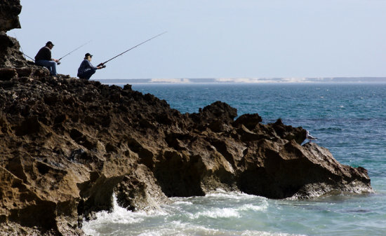 fishing rods tackle sea rocks