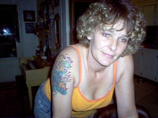 tatoo of Dad name on her arm after he died