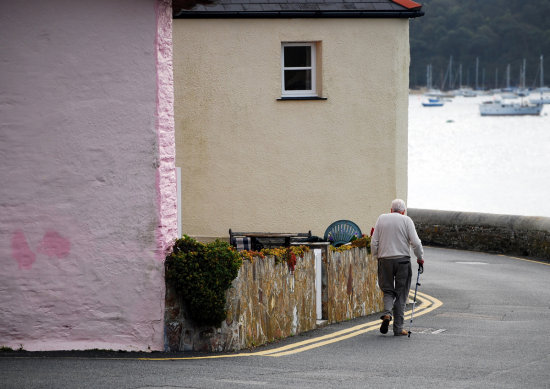 old man walk cottage stmawes cornwall street sea