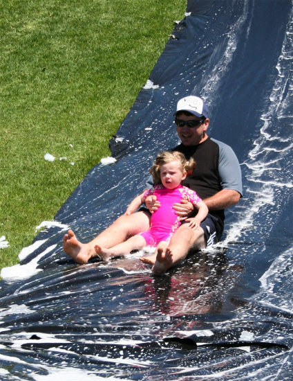 Dad and Lauren going down the waterslide