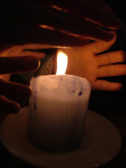 candlelight hands light