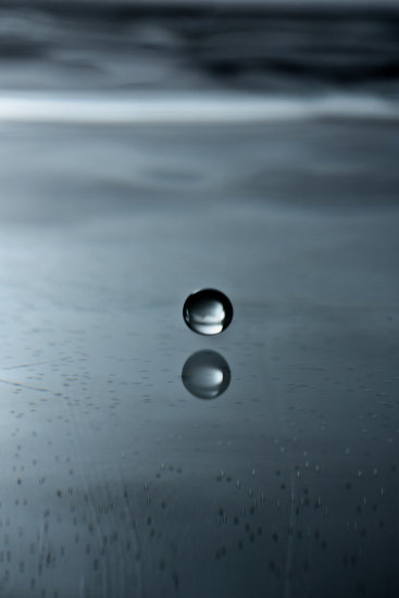 A drop of water about to splash down