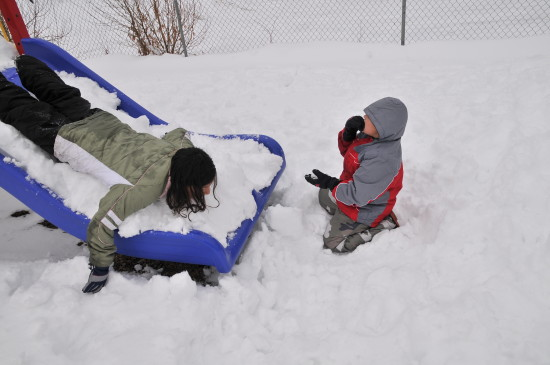 burney california kids nina97 sliding down the slide and kenster eating snow