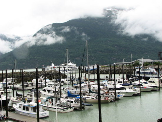 northtoalaska coralprincess alaska skagway ships boats clouds mountains