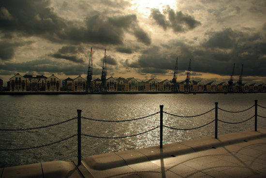 royal victoria dock docklands london houses cranes water clouds sunset dusk