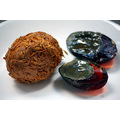 Preserved duck egg (left)  covered in a clay-like mixture of quicklime, salt and rice husks. This...
