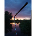 narrowboat tiller water river canal sunset brass