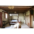 11. ....a huge bedroom with a four poster bed at a slightly wonky angle because of the ancient un...