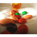pills mms painkillers light colour red green brown orange bottle