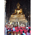 Families come to give reverence at the Wat Suthat Temple in Bangkok Thailand