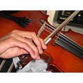 2. so Stephen made a little guiding device to fit on his violin out of a pair of chopsicks and a ...