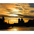 Seine Notre Dame cathedral sunset river silhouette gold atmosphere