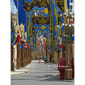 Walking Through A Decorated Street In Qrendi  A street in Qrendi in Malta decorated for the fea...