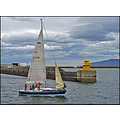 sailing boat reykjavi harbour harbor iceland sea lighthouse pier