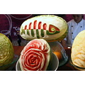 opening the lettuce and the fish restaurant logo water melon carved
