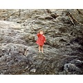 Me on the same rocks as before aged 2 or 3!