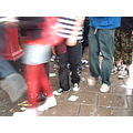 footsteps feet legs shoes walking movement waiting queue queing blur trainers