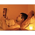 man book candle evening reading bed soft ligh