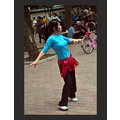 she is dancing all by herself in the park.   most others are dancing with a partner or in large ...
