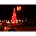 on the road a tree all lit up