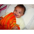 orange towel baby girl smiling smile