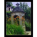 museum old house well nature flowers grass sky