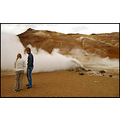 nature hot spout geysir steam vent brownish people arid desolate barren