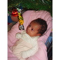 under cristmas tree baby girl newborn child