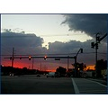 nightfall sunset city lane road lamp pole house cars cloud sky