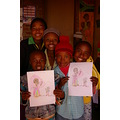 Party of five showing off their beautiful smiles and the pictures they colored.
