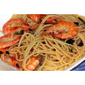 Lemon and white wine cooked prawns with spaghetti.