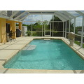 36 FOOT HEATED POOL AND SCREENED LANAI AREA